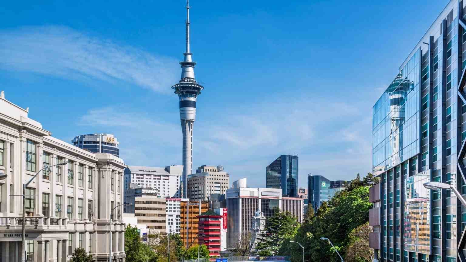 New Zealand, North Island, Auckland, Wellesley Street East with Auckland University of Technology and University of Auckland, dominated by the 328 metre Sky Tower, the tallest free-standing structure in the Southern Hemisphere (New Zealand, North Isla