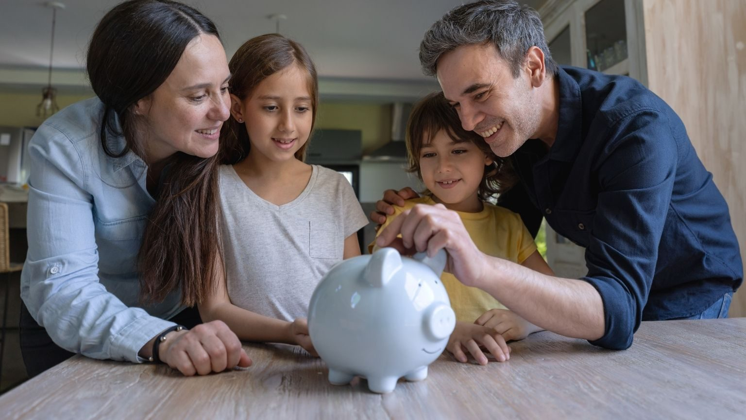 Couple teaching kids how to save money