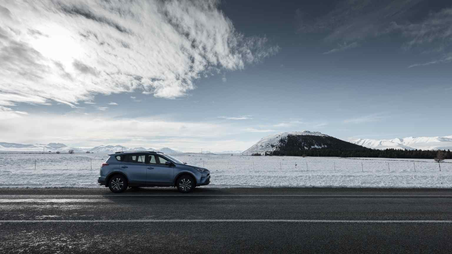 Car against snowy New Zealand backdrop