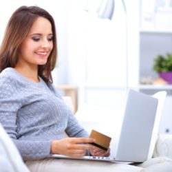 Beautiful-smiling-woman-with-laptop-and-a-credit-card-featured-shutterstock