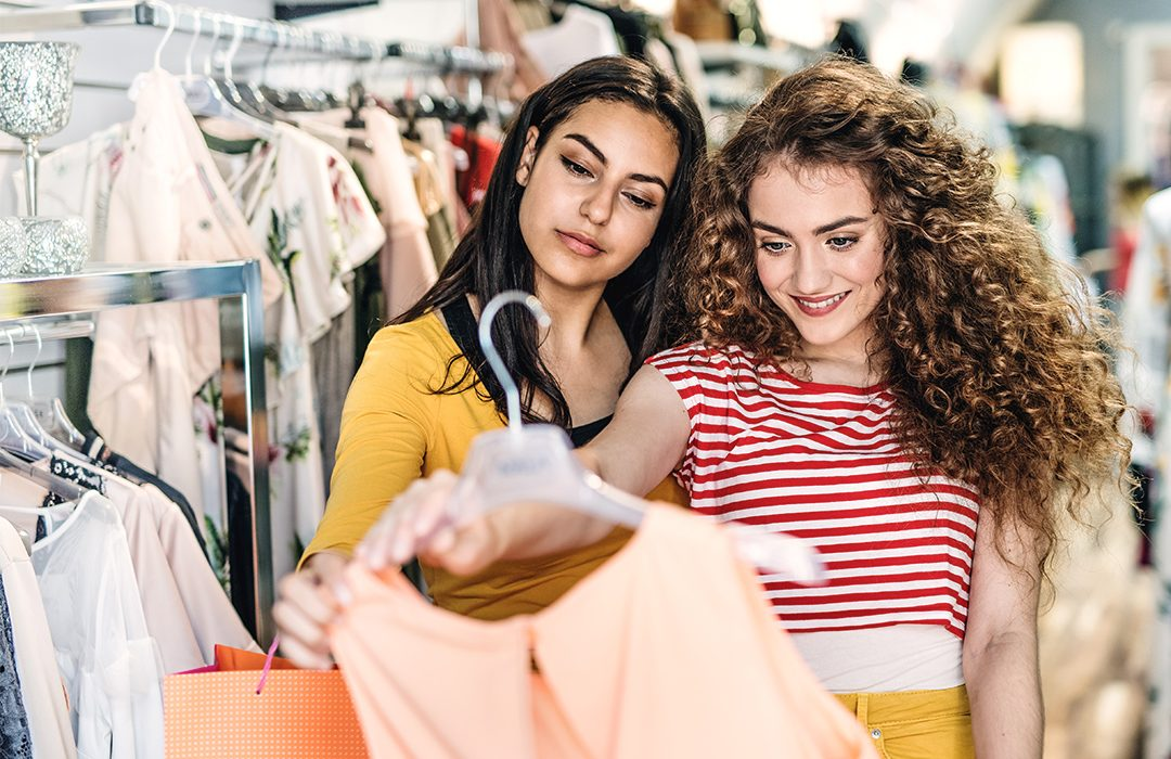 Beautiful teenage girls shopping for clothes.