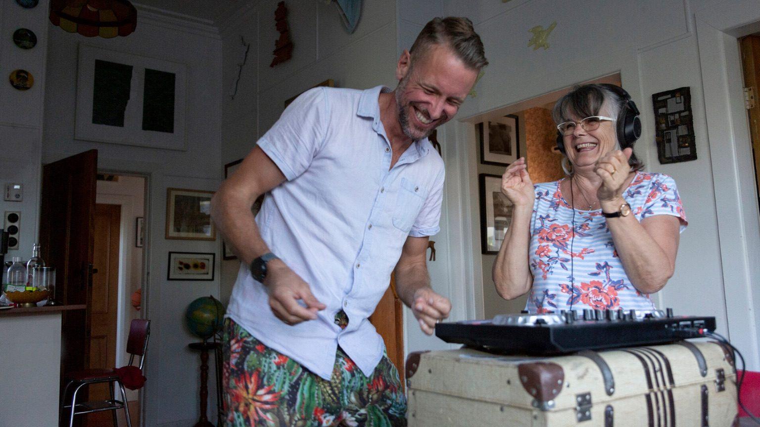 Man dancing next to older woman