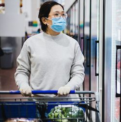 Asian female wearing a face mask shopping at the supermarket