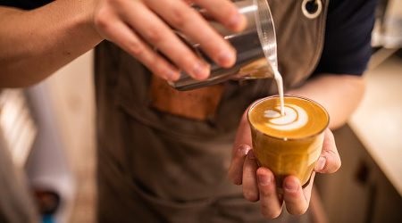 Barista make coffee cup latte art