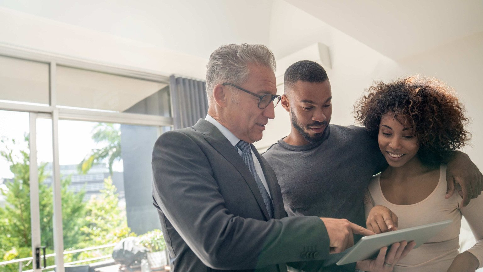 Couple looking at insurance policy with an adviser