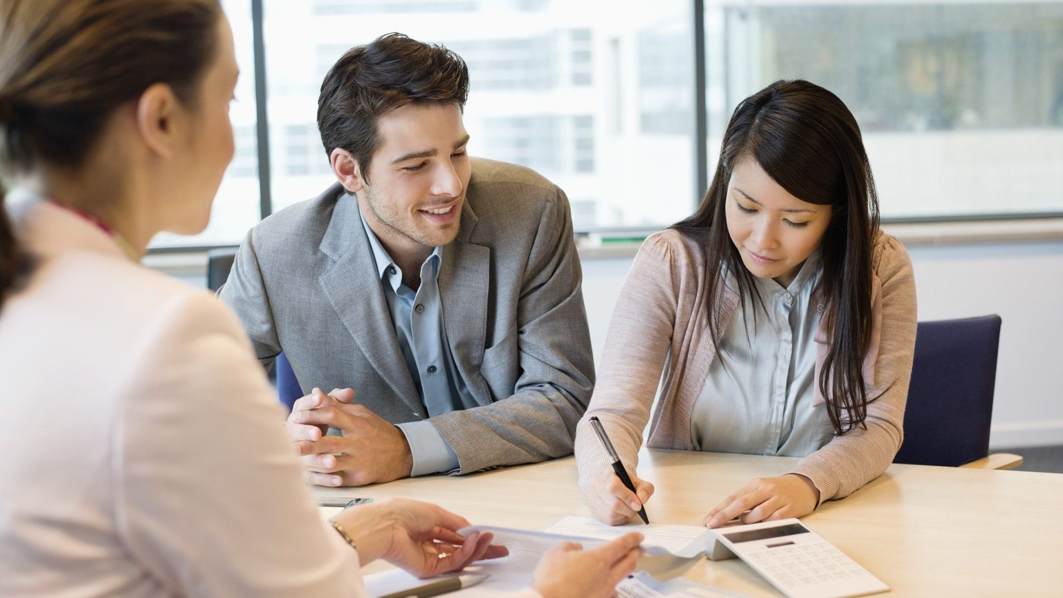 Couple reviewing their budget with a financial advisor