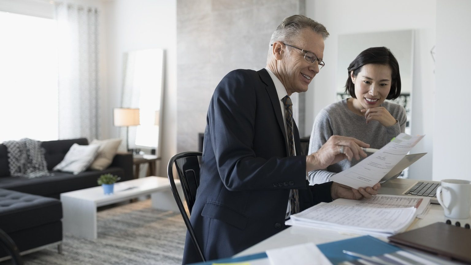 Woman reviewing loan details with a financial advisor