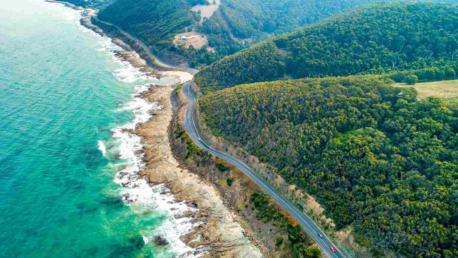 Cars driving on Great Ocean Road, Victoria, Australia  - aerial view