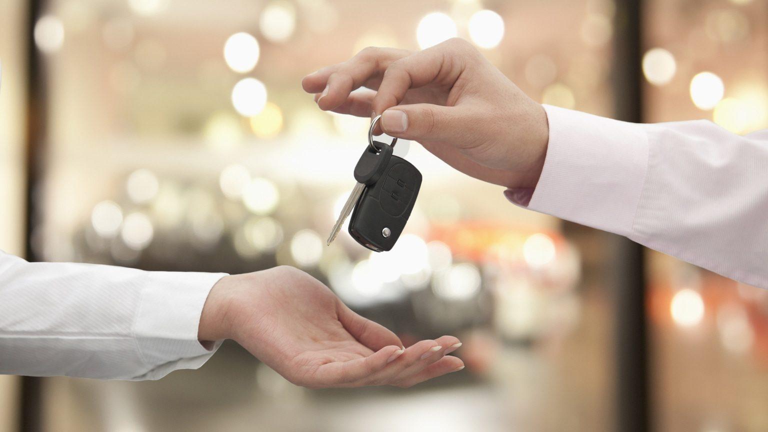 Car keys passing between two hands