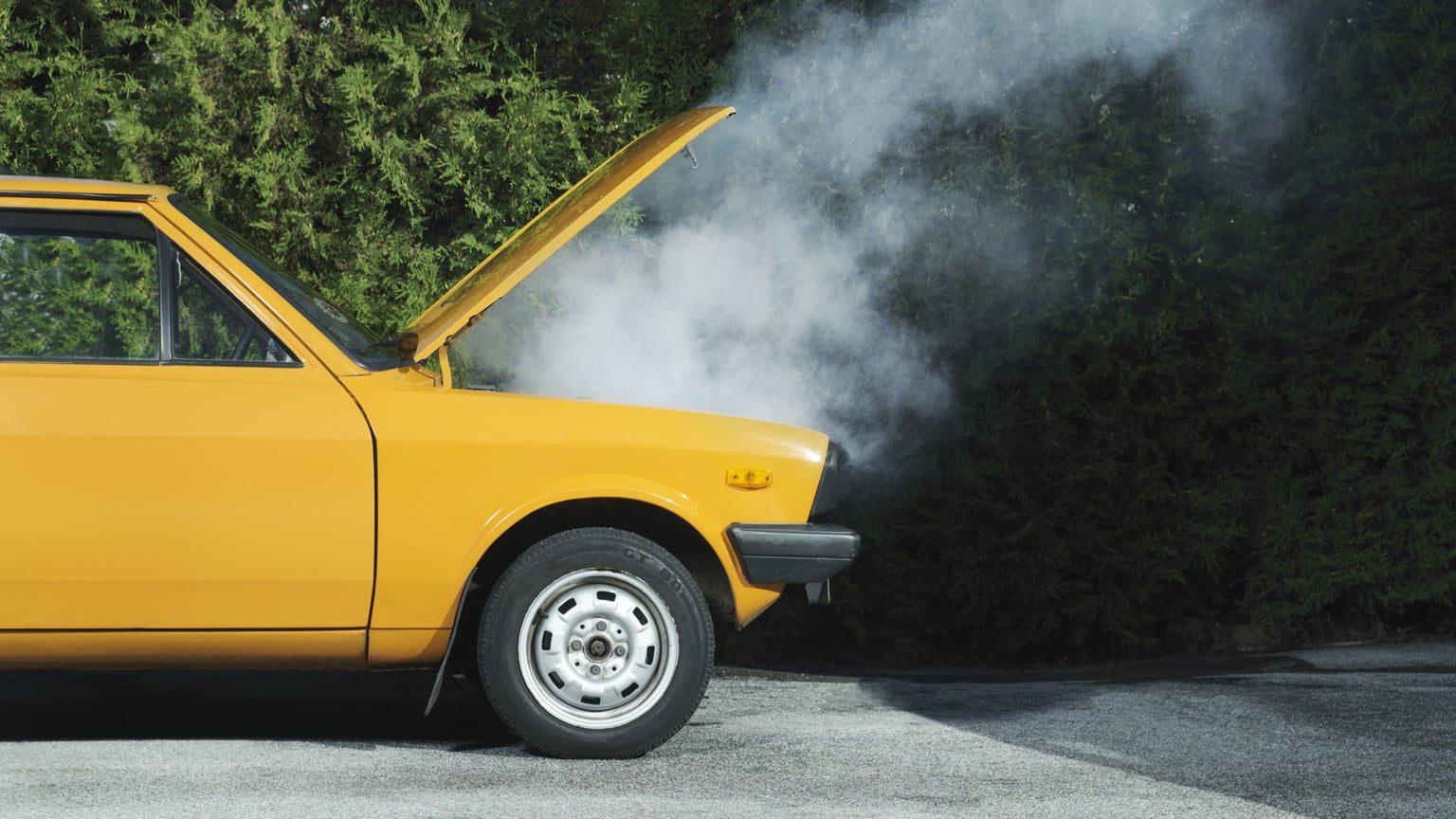 Broken Down Yellow Car On Roadside