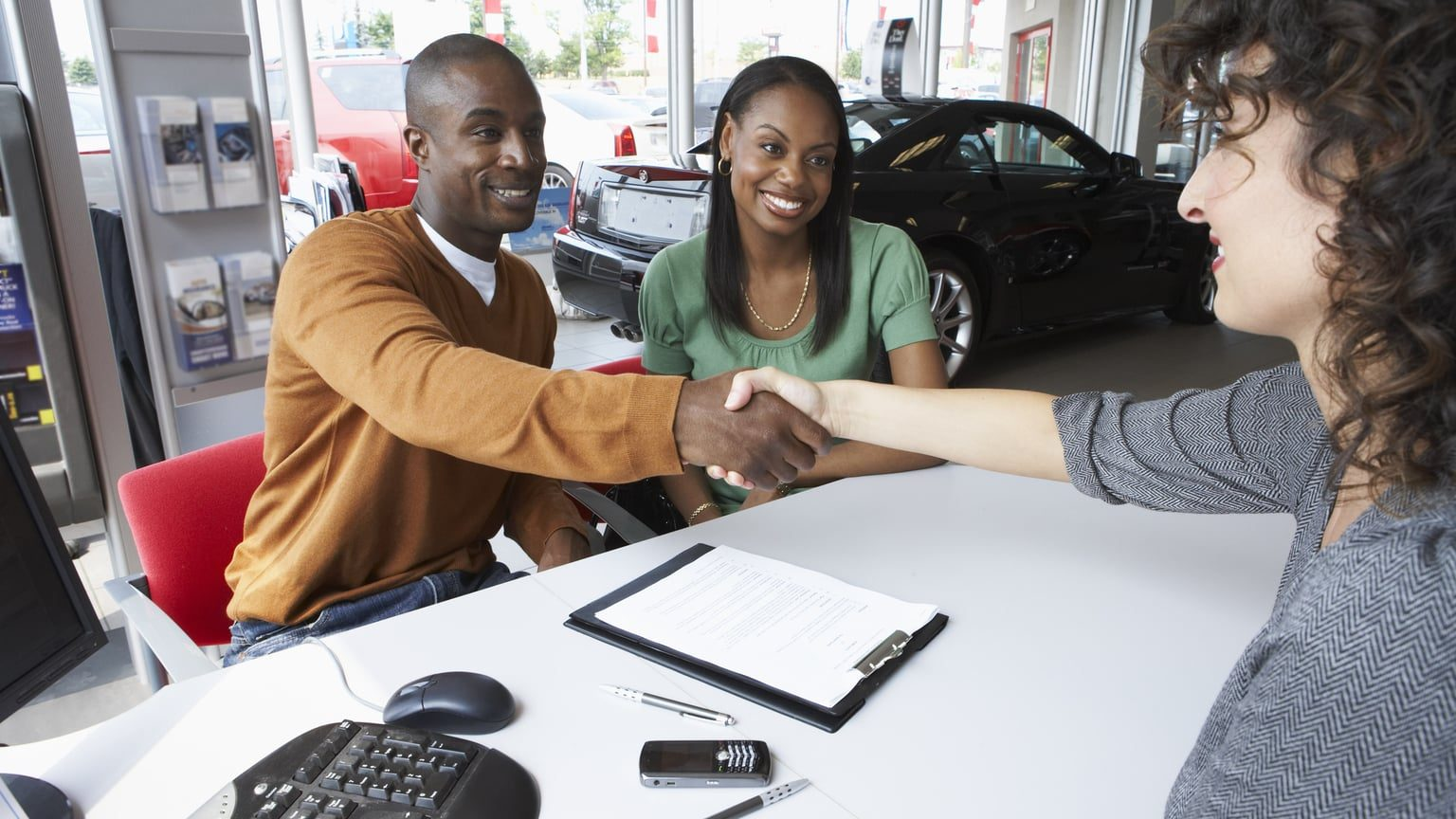 Couple buying a used car