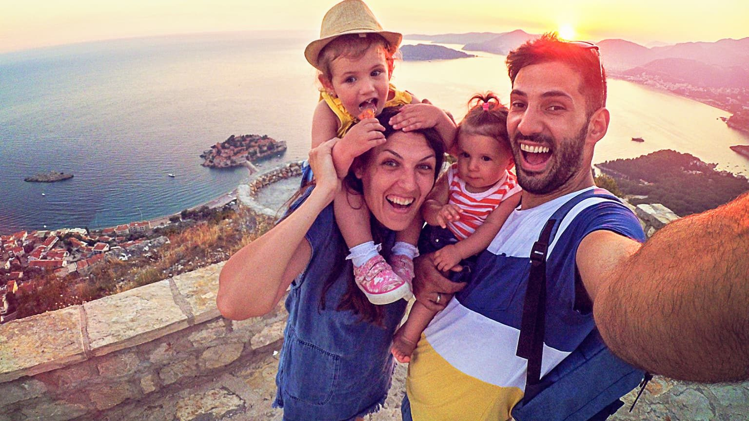 Happy young family taking a selfie on vacation.