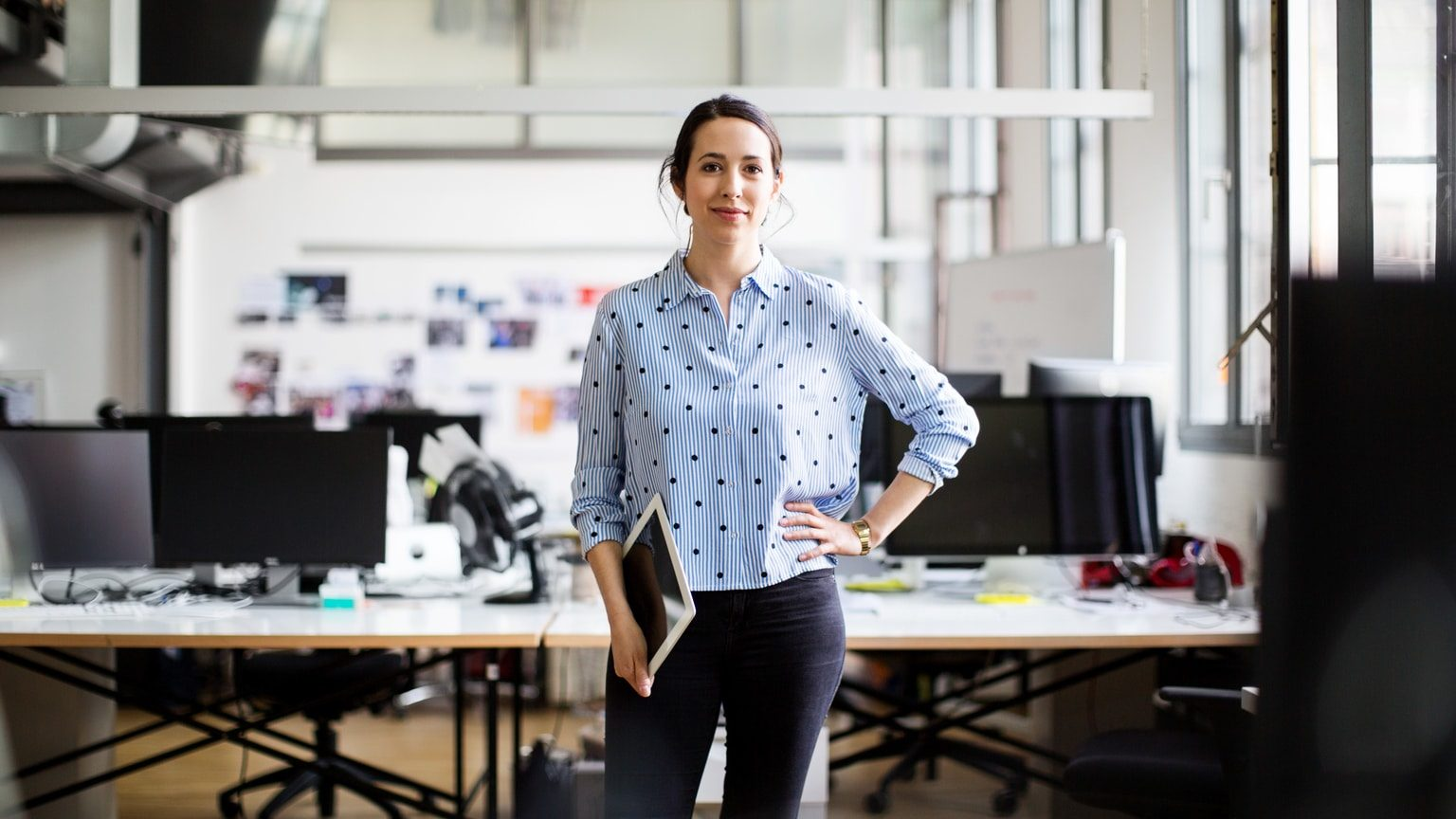 Small business owner standing in her office