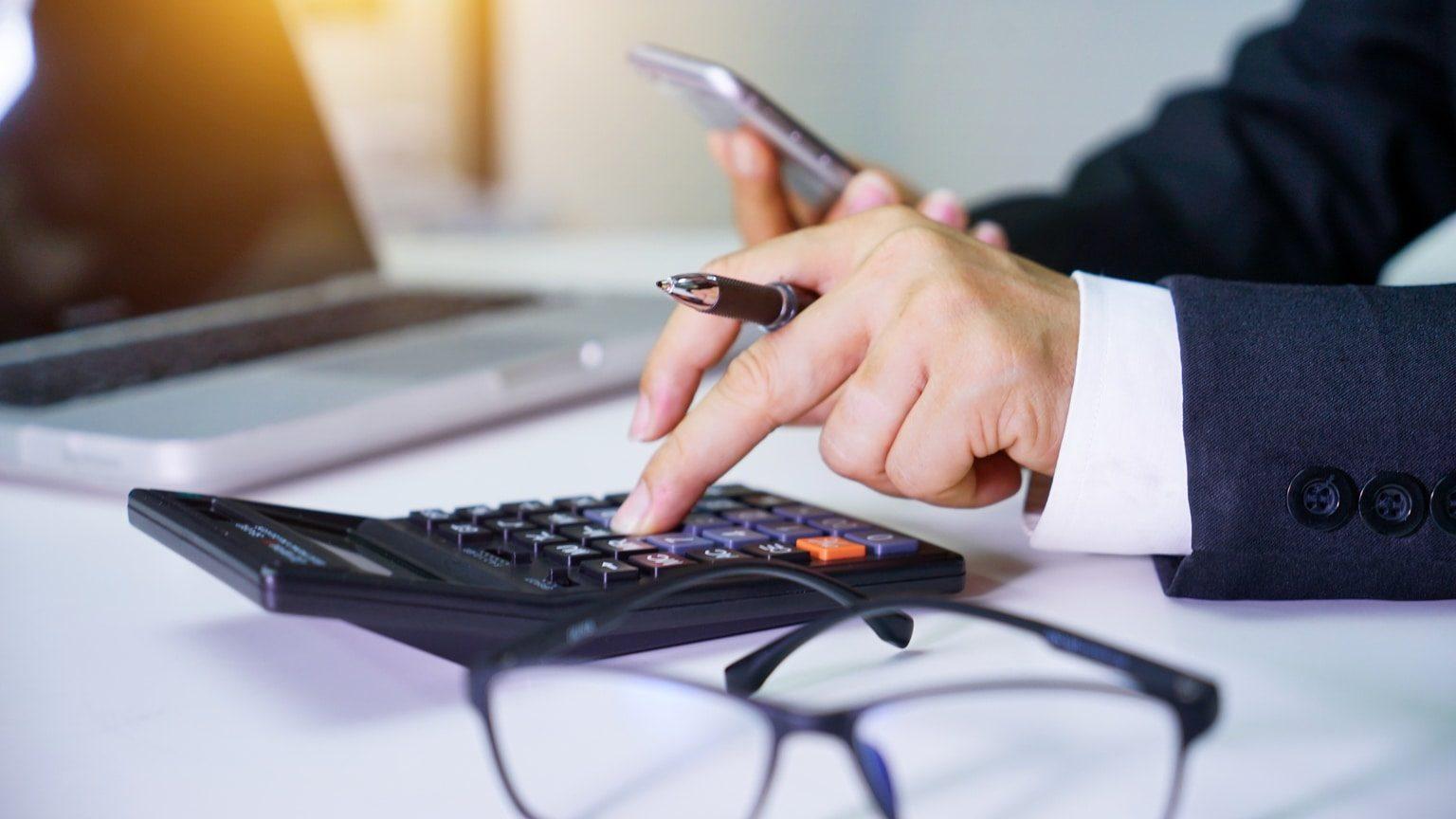 Closeup of businessman performing financial calculations