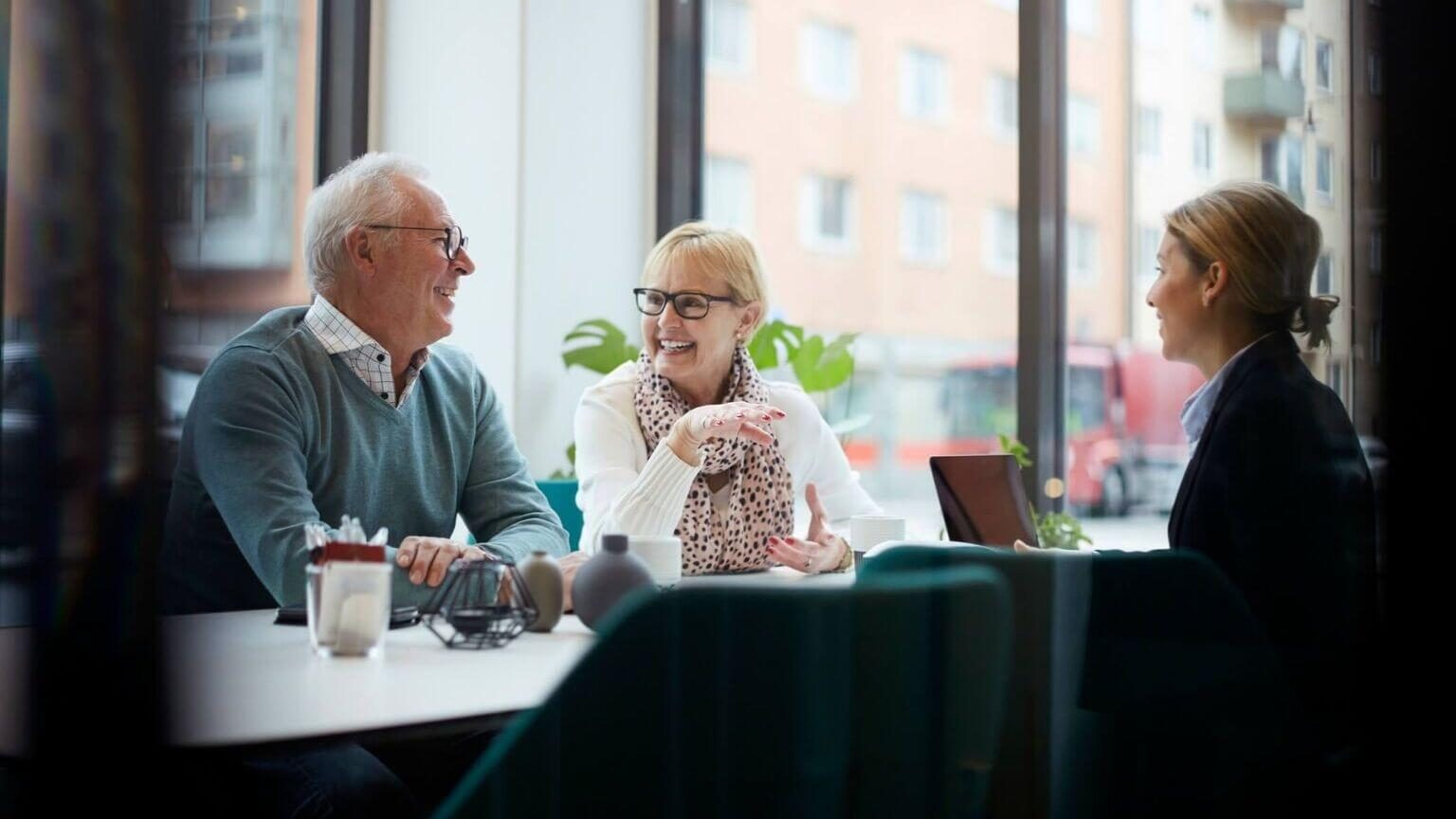 Elderly couple considered the best GIC rates in Canada as they look at low risk investments.