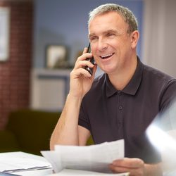 Man sitting at a table reviewing his credit report