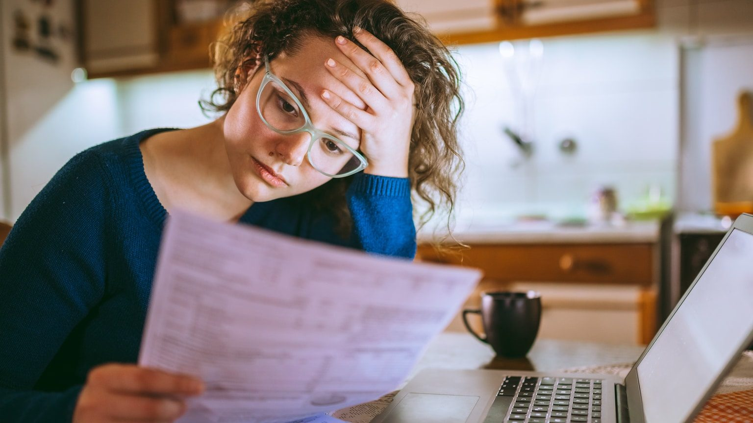 Stressed woman looking at her bills