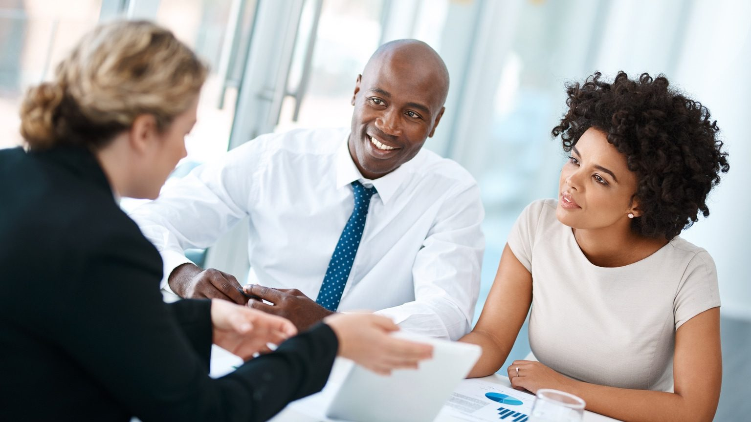 Young couple meeting with a financial planner