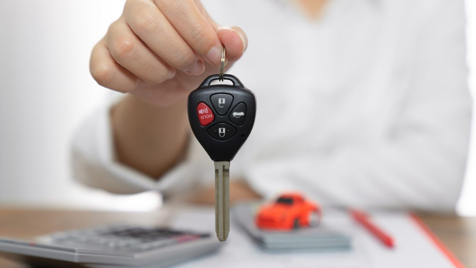 Women holding car keys, car loan concept
