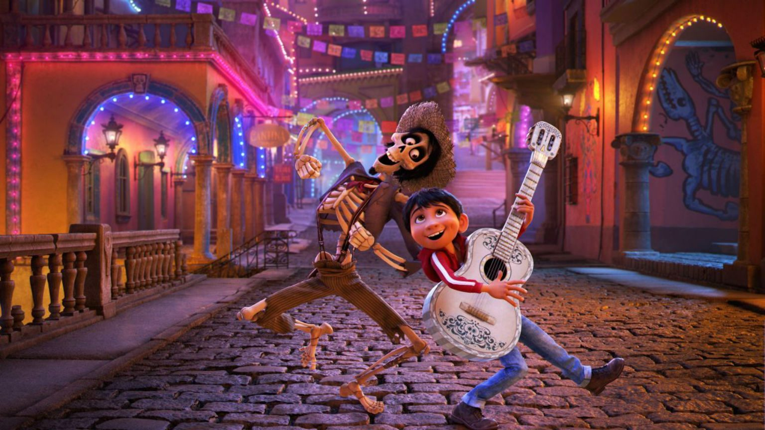 Two characters dancing from Pixar's Coco.