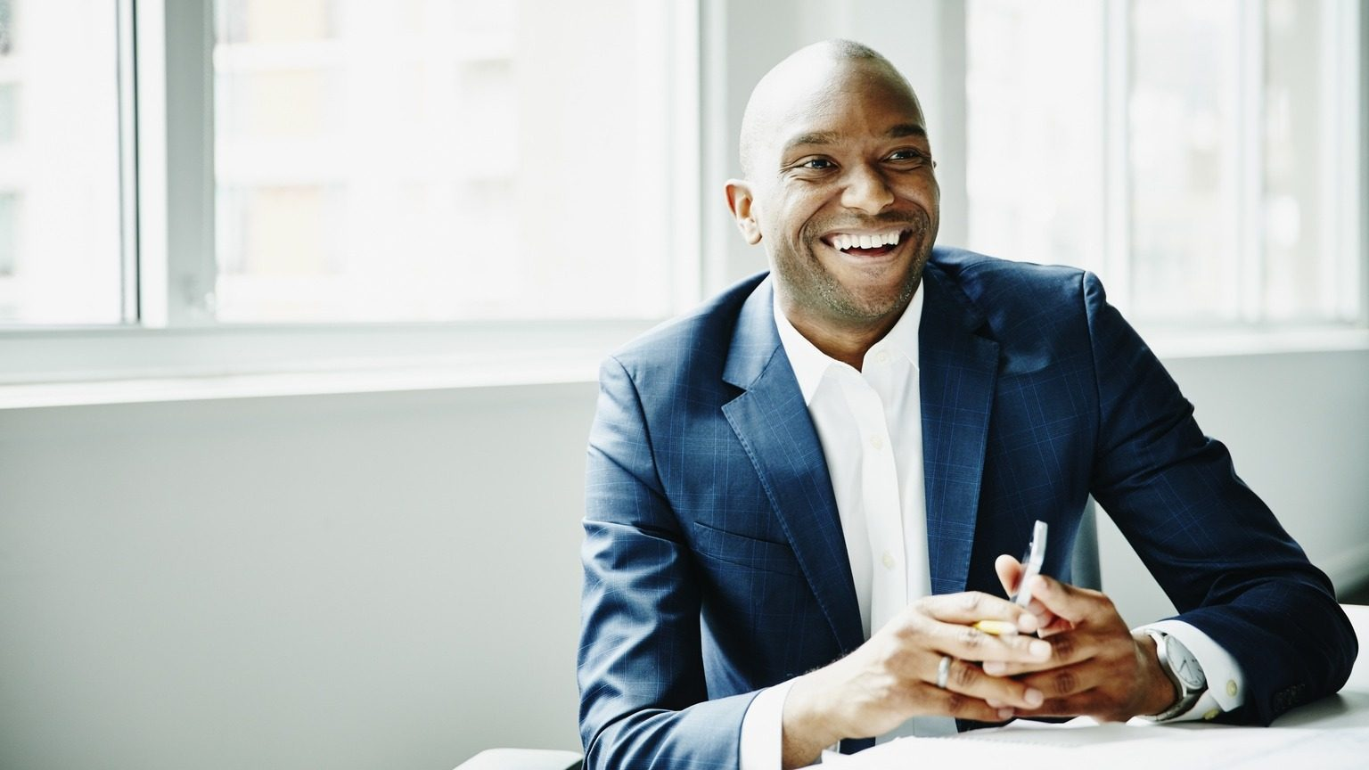 Smiling businessman sitting at a table