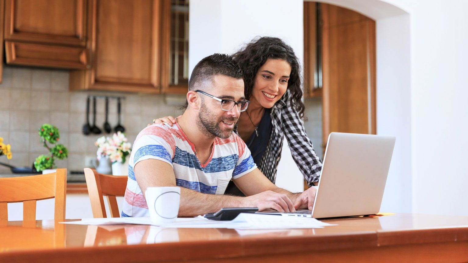 Young couple reviewing their financial options online