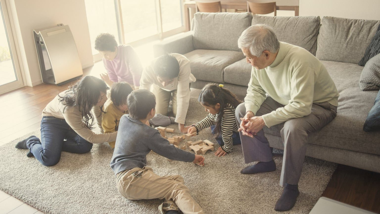 Multigenerational family playing in living room