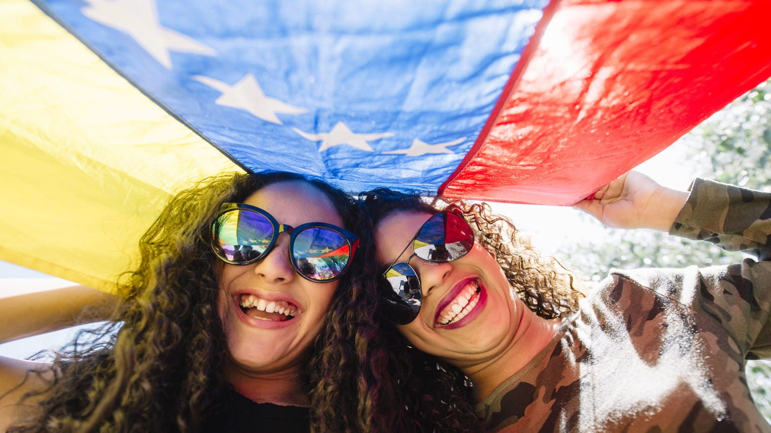 Young smiling girls with Venezuela flag