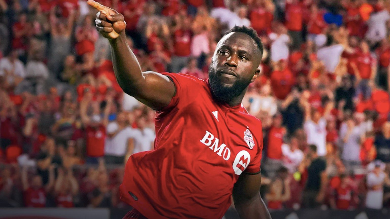 Toronto FC player Jozy Altidore pointing to crowd while running