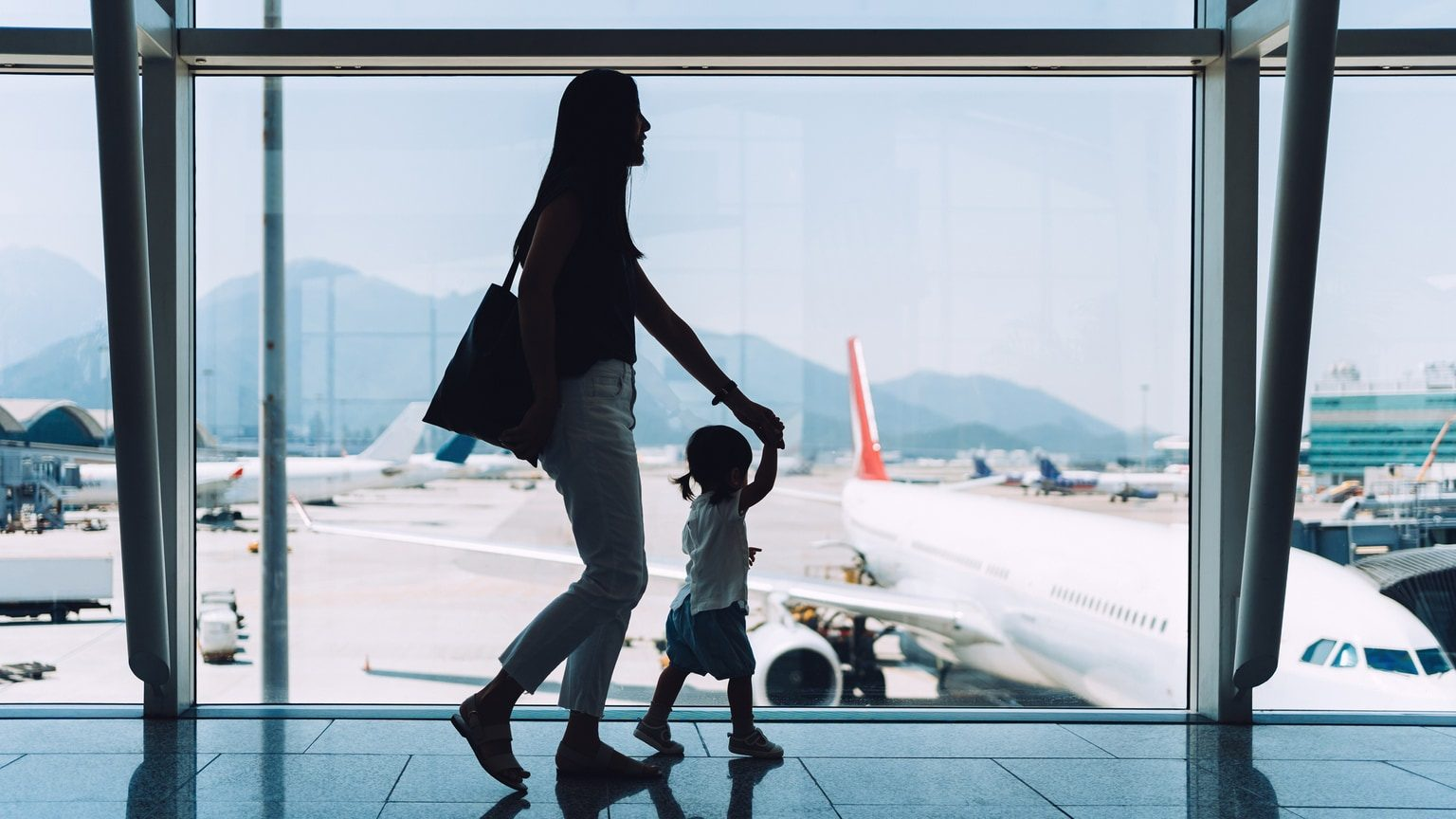 Mother and daughter walking in airport