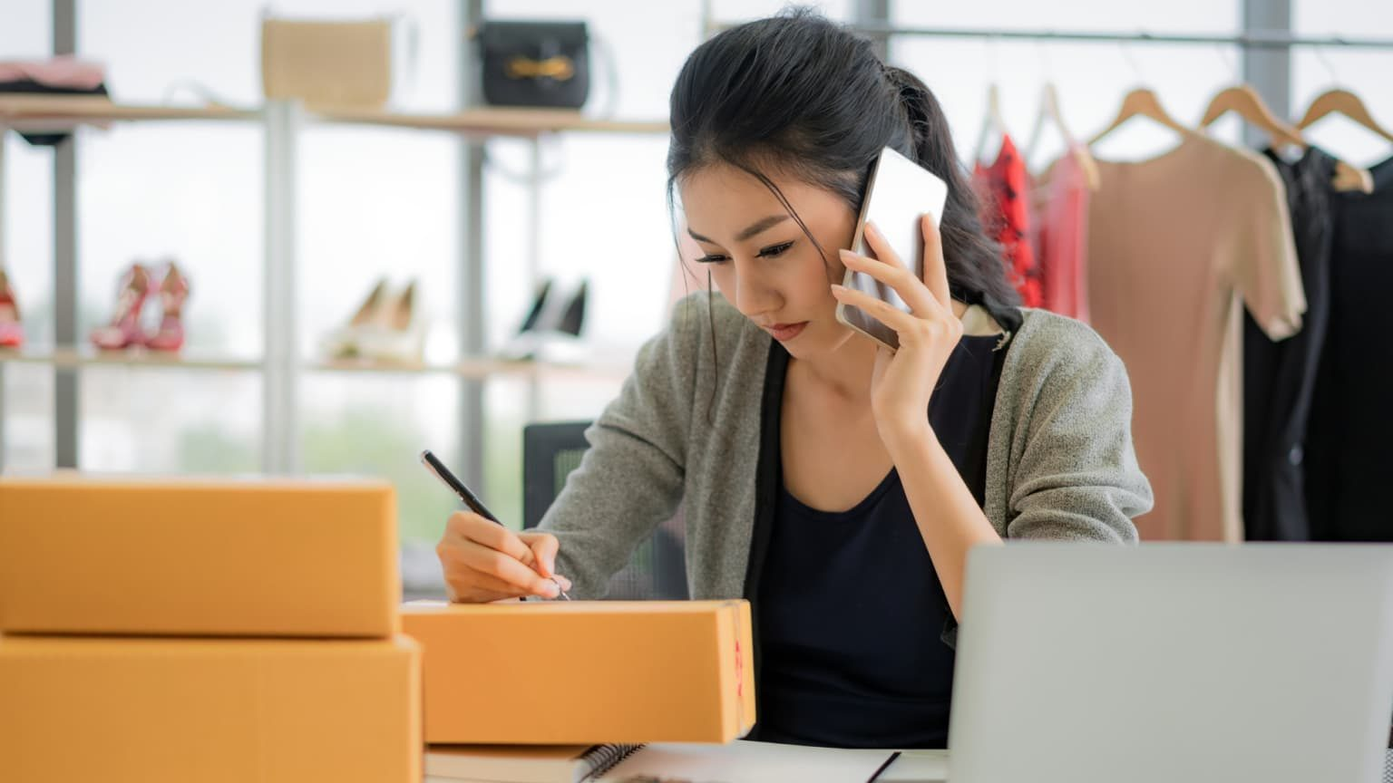 Female business owner preparing shipment of orders