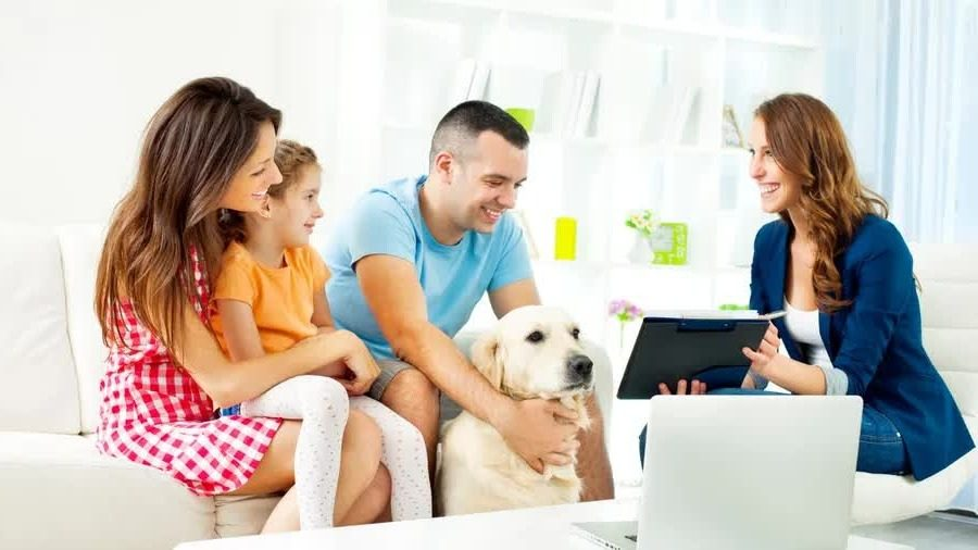 Young family reviewing life insurance options