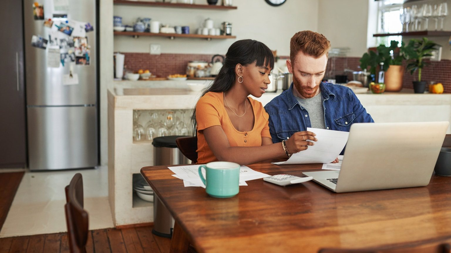 Young couple investing online using a robo advisor