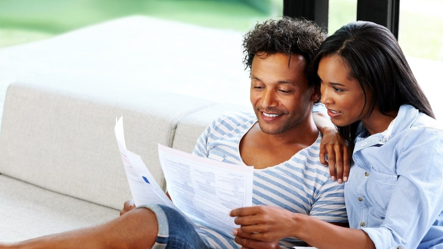 Young couple looking at life insurance documents together