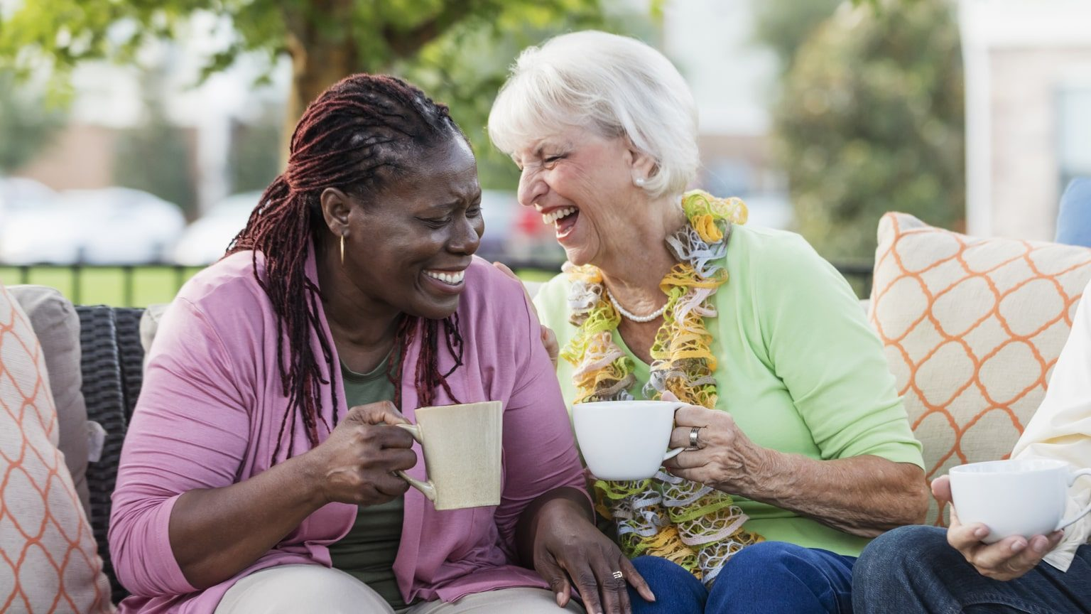 Middle-aged female friends talking and laughing together