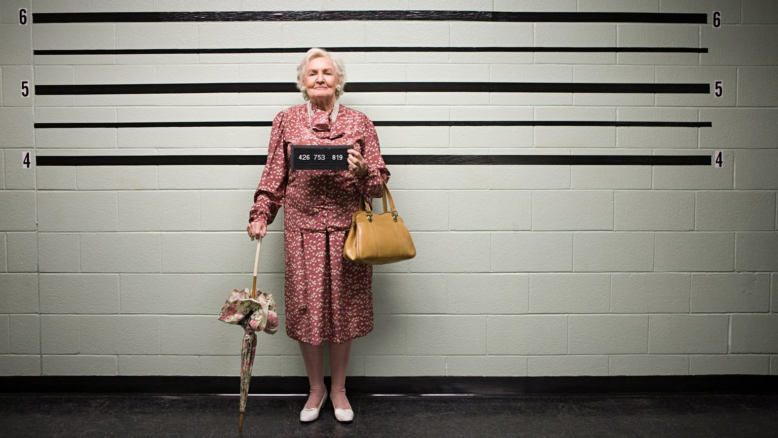 Elderly woman getting a mugshot taken