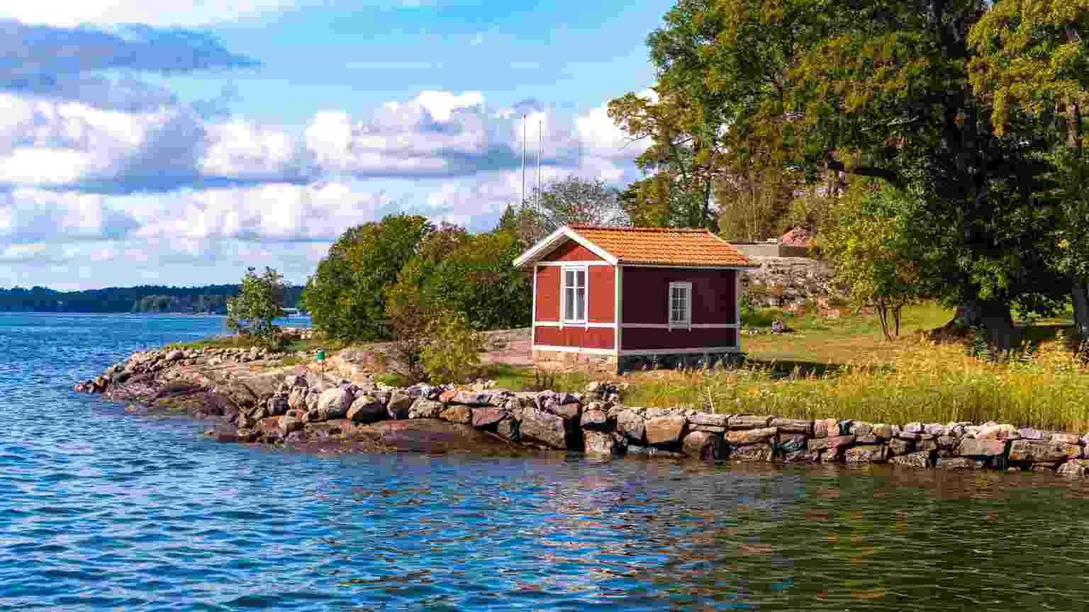 Wooden hut in traditional red at the Archipelago near Stockholm, Sweden