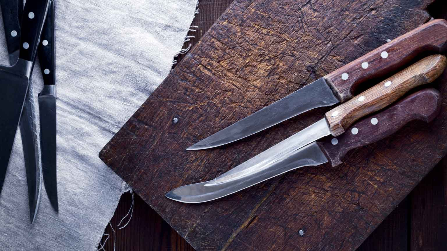 Kitchen Knives And Cutting Board On Table