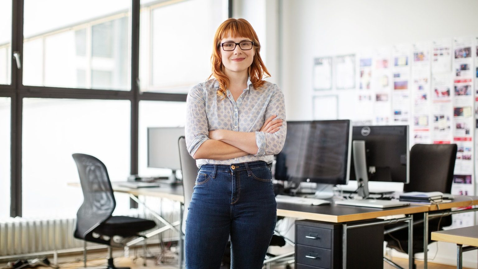 Young Confident Woman Standing Alone In Office