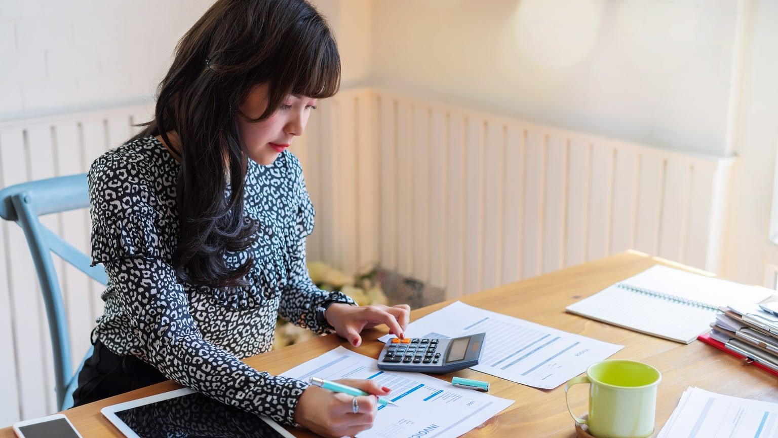 Female entrepreneur calculating business tax deductions