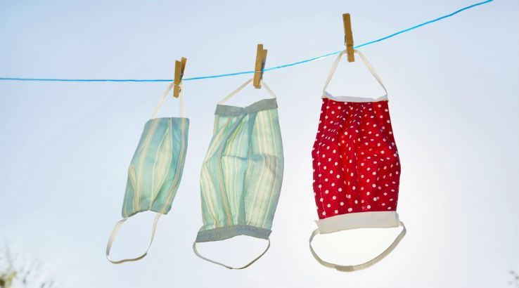 Reusable face masks hanging on a clothes line to dry