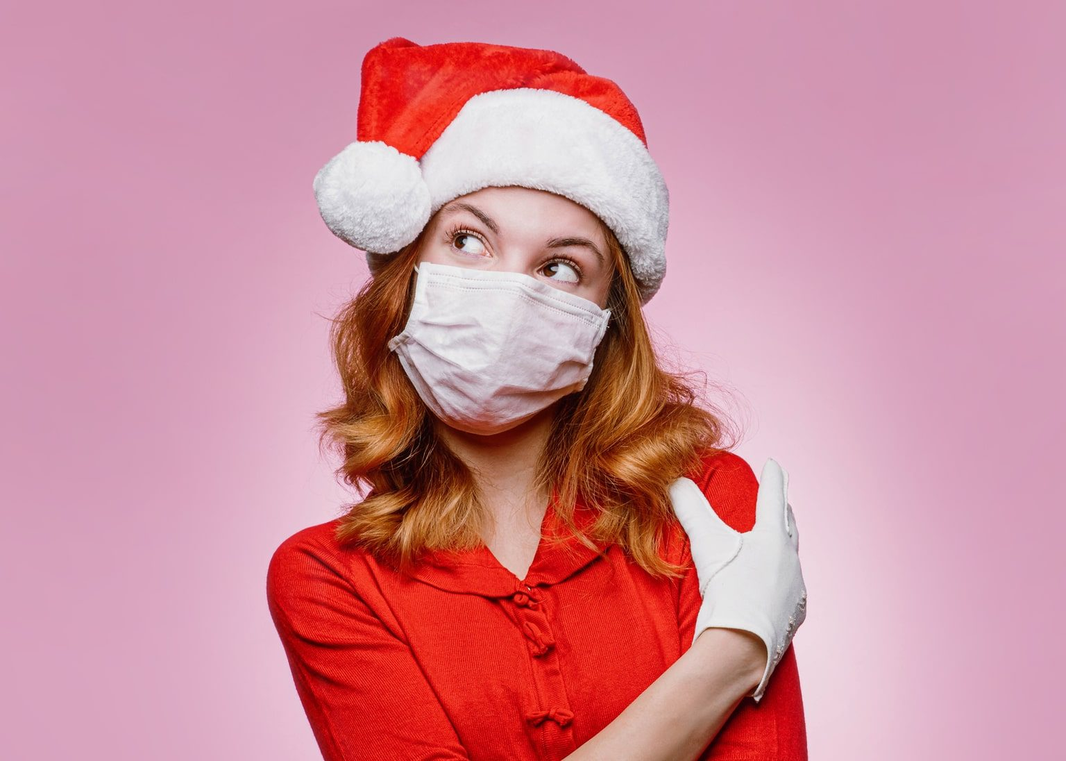 Woman dressed as Santa's helper wearing a protective face mask