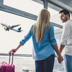 couple watching plane taking off 250x250 optimised Shutterstock