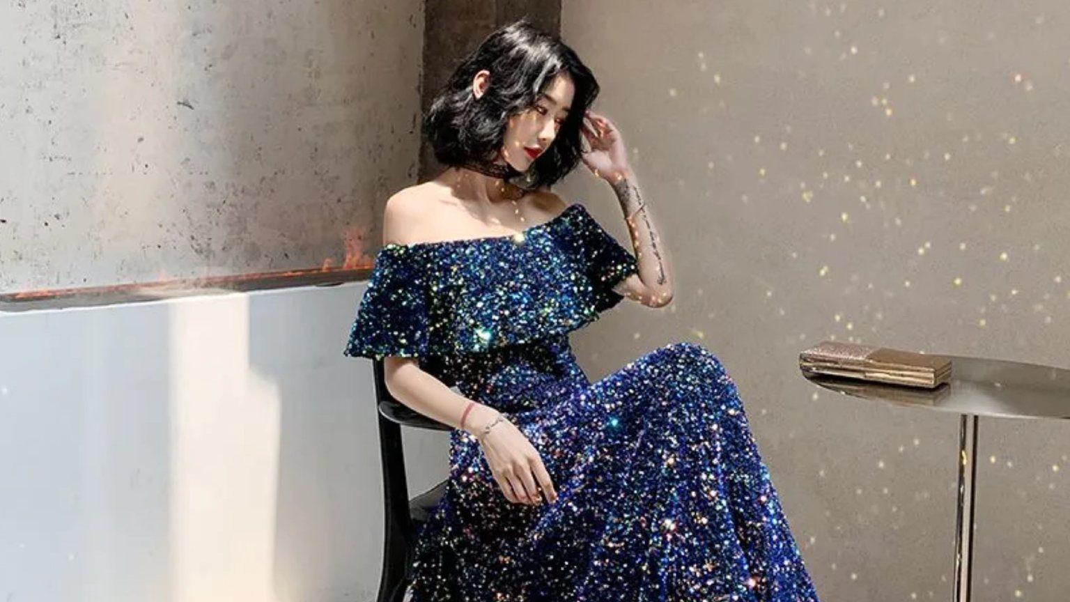 Model in dark blue party dress